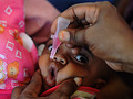 A Somali baby is given a polio vaccination