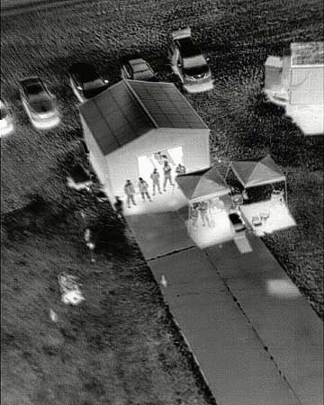 This photo was taken from a small unmanned helicopter using an infrared camera during a training flight May 12, 2013 in Grand Forks, N.D. The infrared camera shows people who were not seen using a visible light digital camera.