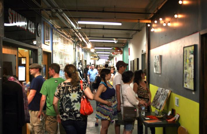 The halls of the Northrup King building are filled with artists, patrons and families exploring the artist studios made available during Art-A-Whirl in northeast Minneapolis.