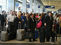 American Airlines passengers wait in line
