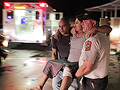 Carrying injured man after tornado