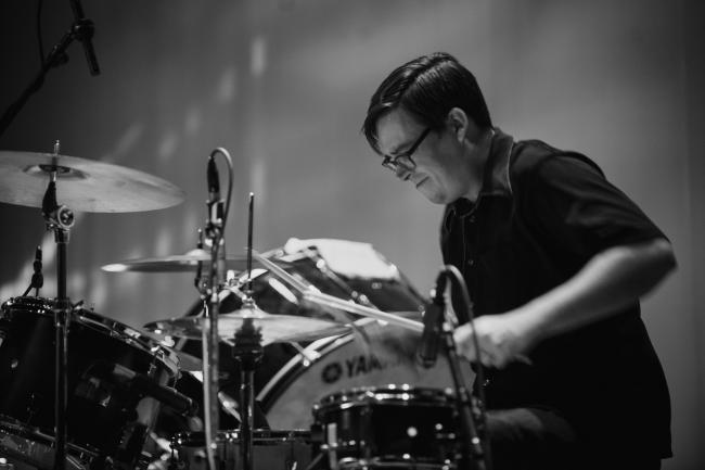 Dessa's drummer performing at the Fitzgerald Theater