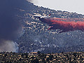 An aerial tanker drops fire retardant