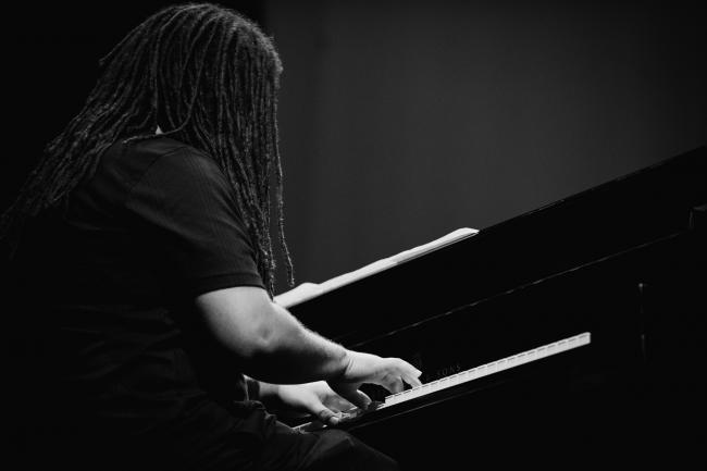 Dessa's piano player performing at the Fitzgerald Theater