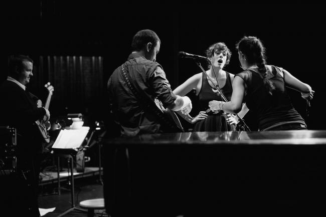 Dessa and her band performing at the Fitzgerald Theater