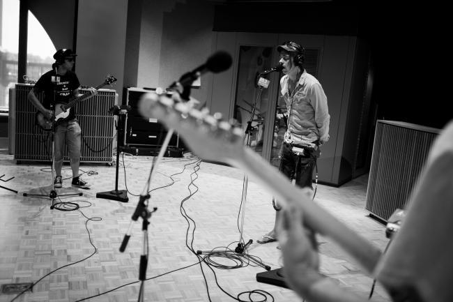 Vocalist Brenden Green, bassist Andy Meuwissen, & guitarist Jackson Atkins of The Goondas sound checking in The Current studios.