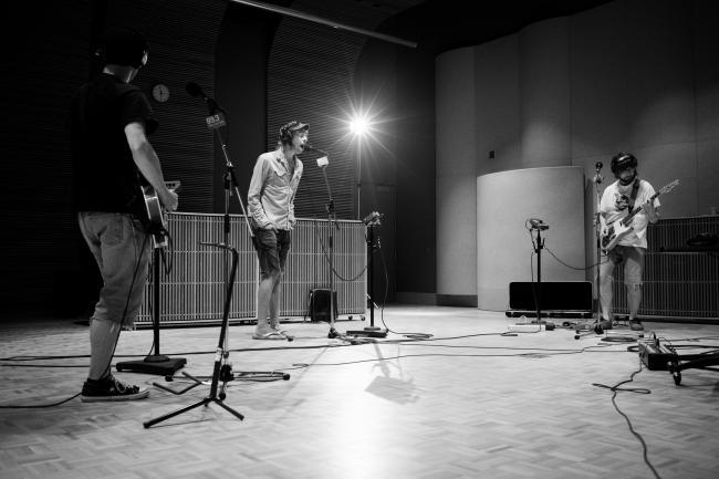 Vocalist Brenden Green, bassist Andy Meuwissen, & guitarist Jackson Atkins of The Goondas performing in The Current studios.