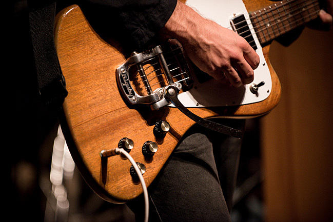 A close-up look at the body of Bryce Dessner's 1965 Gibson Firebird, taken during The National's live performance in the UBS Forum at Minnesota Public Radio.