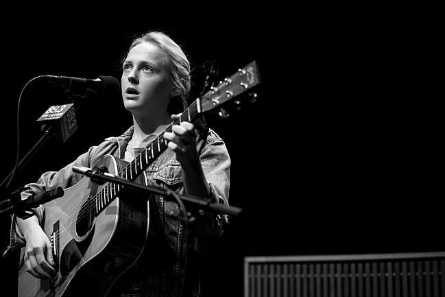 Laura Marling sings and looks to the crowd in Minnesota Public Radio's UBS Forum. August 14, 2013.