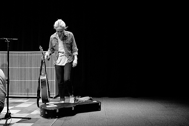 Laura sets down her guitar before guests arrive at the UBS Forum. August 14, 2013.