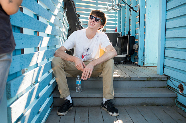 Evan Slack of Bomba De Luz relaxes after performing on the MPR Stage at the Minnesota State Fair. August 23, 2013.