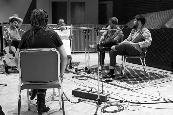 Mary Lucia chats with Mumford & Sons in The Current studios. Left to right: Marcus Mumford, Mary Lucia, Ben Lovett, Ted Dwane, and Winston Marshall. September 4, 2013.