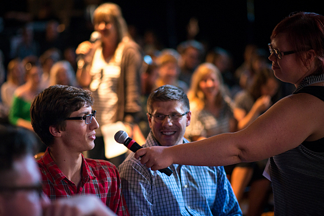 Jill Riley of The Morning Show gives a listener to voice his opinion at The Current's public music meeting.
