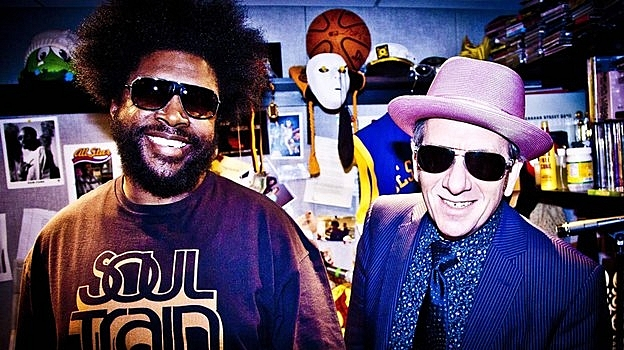 ?uestlove and The Roots play backing band to Elvis Costello on the new collaborative album <em>Wise Up Ghost</em>.