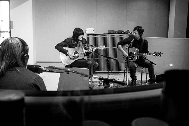 Mary Lucia looks on to  J.D. King and Pete Yorn of The Olms while they perform live in The Current studios.