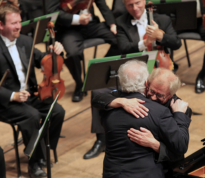 Conductor Osmo Vanska hugs pianist Emmanuel Ax following a Beethoven Concerto on Friday, Oct. 4, 2013.