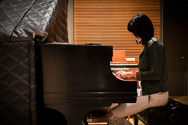 Phantogram's Sarah Barthel plays a grand piano in The Current studios.