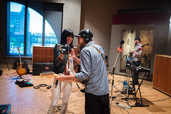 Sarah Barthel and Josh Carter of Phantogram have a look at the photo Sarah snapped in The Current studios.