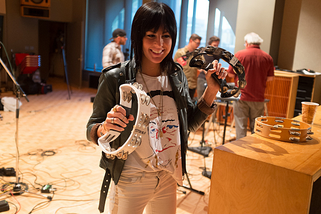 Singer Sarah Barthel plays around with tambourines after a live set in The Current studios.