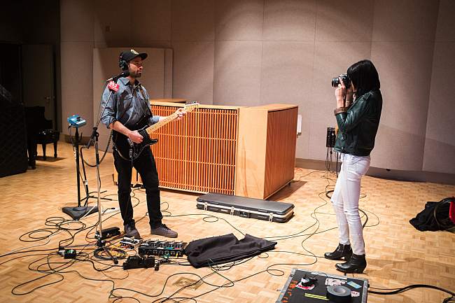 """Sarah Barthel snaps Josh Carter's photo after performing """"Black Out Days"""" live in The Current studios."""
