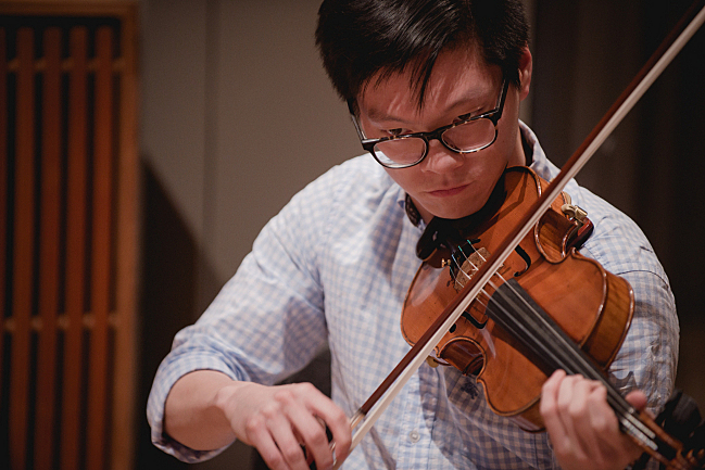 Bryan Lee of the Dover Quartet performs in the studios at American Public Media