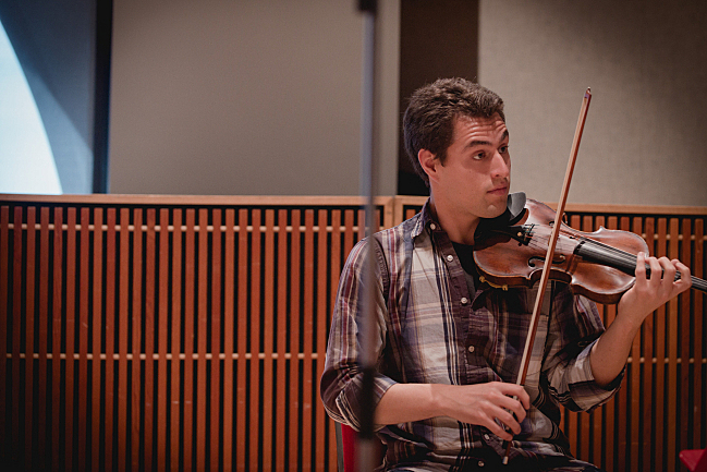 Joel Link of the Dover Quartet performs in the studios at American Public Media.