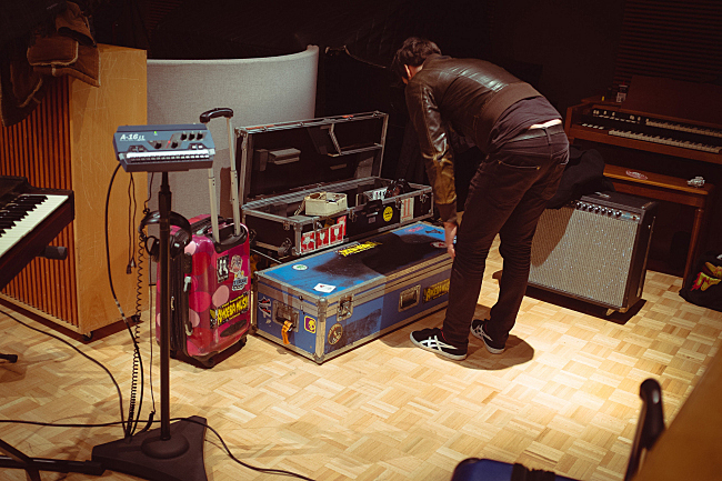 King Khan and the Shrines pack up equipment in The Current studios.