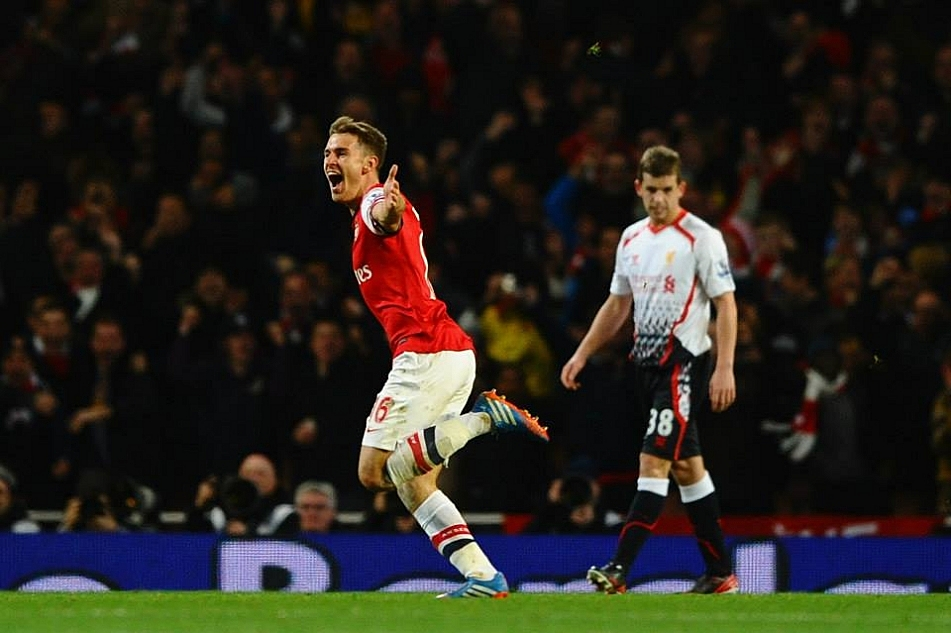 Aaron Ramsey of Arsenal celebrates scoring their second goal against Liverpool on Saturday, Nov. 2, 2013.