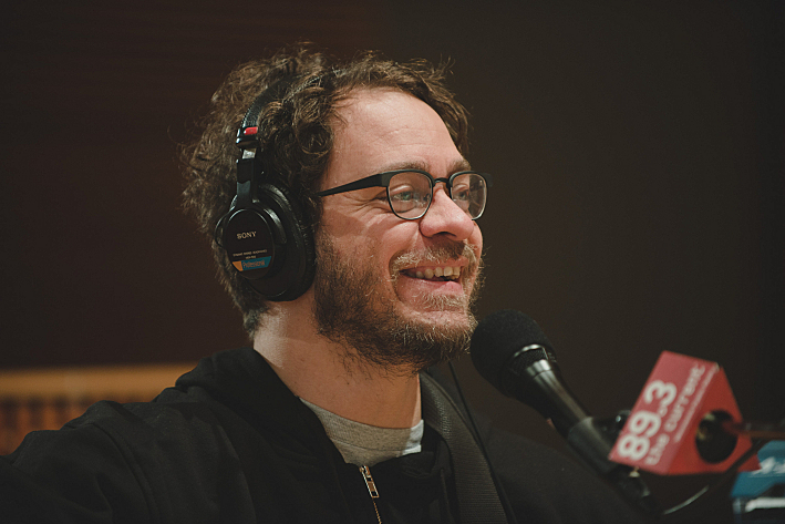 Amos Lee laughs during soundcheck in The Current studios.