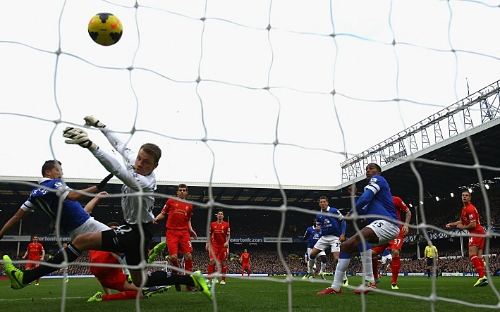 Kevin Mirallas of Everton scores his team's first goal during the derby match with Liverpool. (Getty Images)