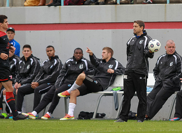 Manny Lagos (holding ball) is the head coach of Minnesota United Football Club. In his playing career, Lagos earned three caps for the U.S. national side.