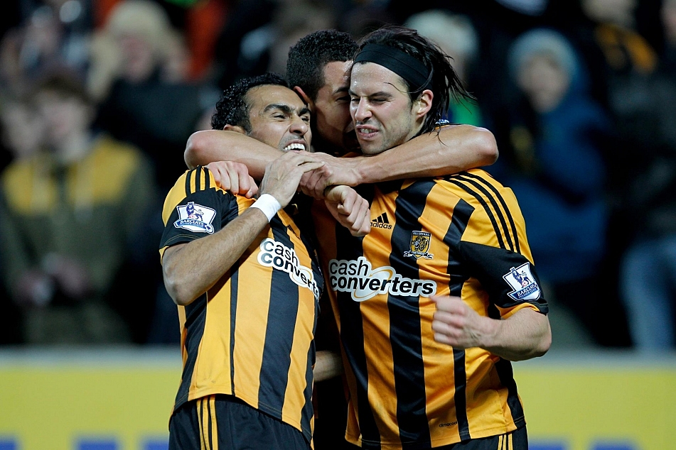 Hull City players celebrate another goal in their 6 - 0 defeat of Fulham on Saturday.