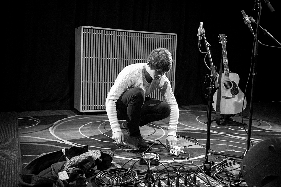 Jake Bugg plugs in his tuner in the UBS Forum at Minnesota Public Radio, home to The Current.