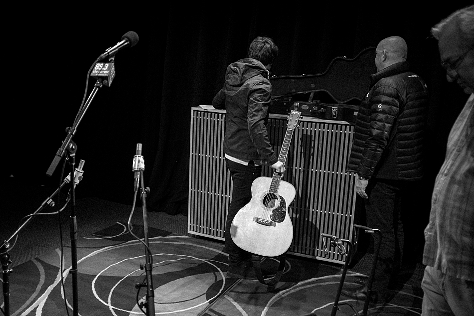 Jake Bugg (center) loads in at the UBS Forum at Minnesota Public Radio. In the foreground at right is The Current's sound engineer, Michael DeMark.