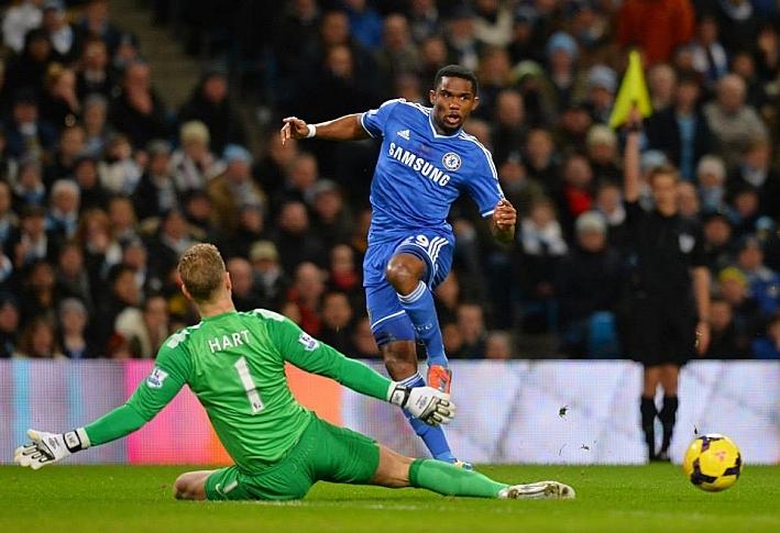 Chelsea's Samuel Eto'o is challenged by Manchester City goalkeeper Joe Hart.
