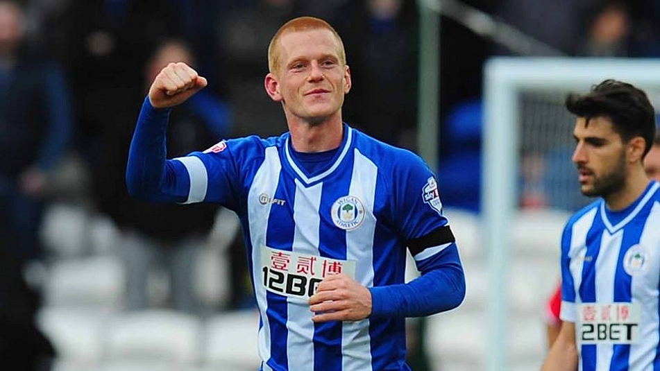 Ben Watson of Wigan Athletic celebrates his goal that saw off Premier League side Cardiff City from the FA Cup.