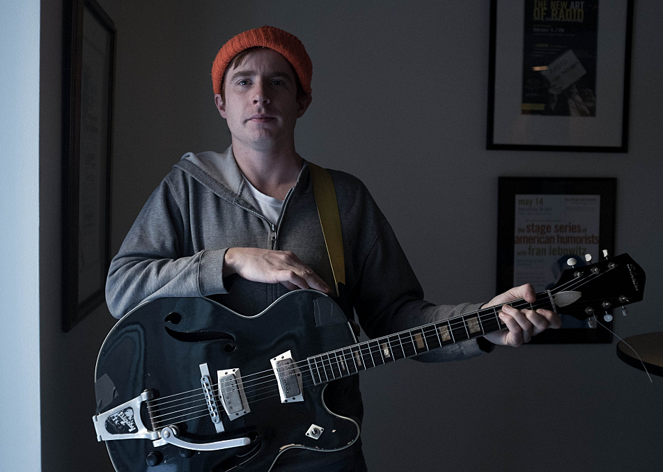 Scott McMicken of Dr. Dog poses with his Silvertone 1446.