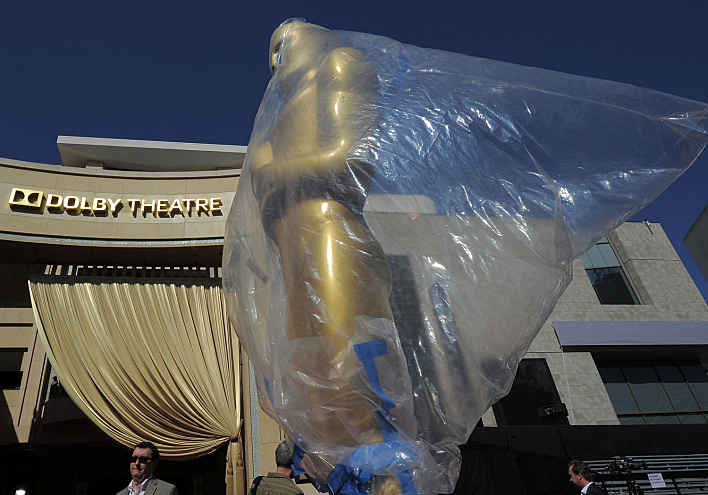 A decorative Oscar statue stands on the red carpet in front of the Dolby Theatre in preparation one day before the 85th Academy Awards on Feb. 23, 2013, in Hollywood, Calif.