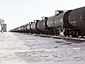 Train of empty tank cars head westbound.