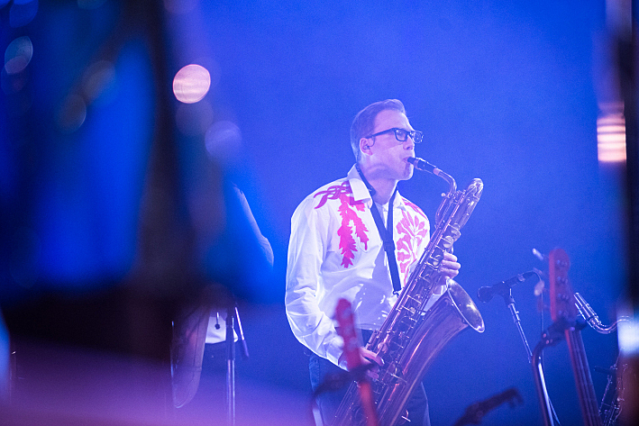Horns add color to the songs early in Arcade Fire's set.