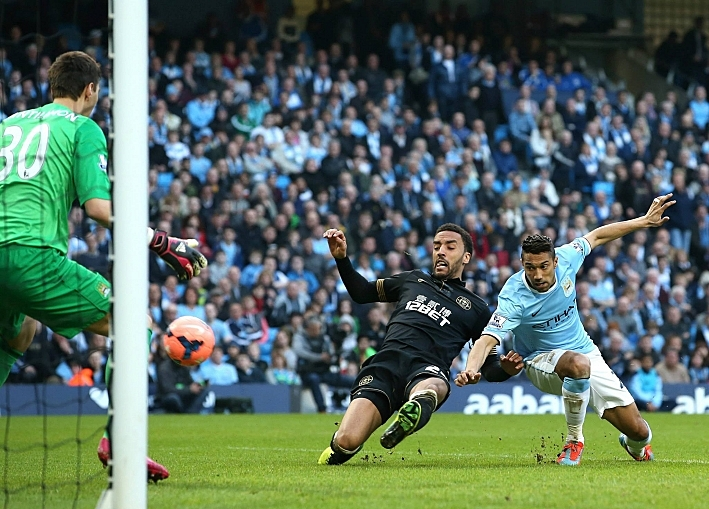James Perch beats Gael Clichy to score Wigan's second goal in their 2-1 win against Manchester City in the FA Cup quarterfinal.