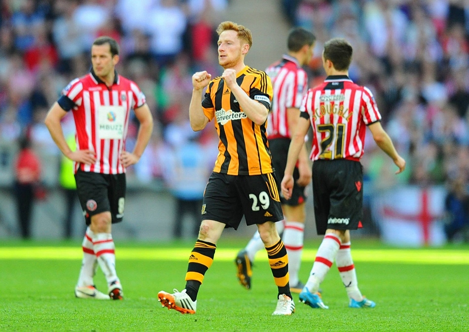 Hull's Stephen Quinn celebrates after his header made it Hull 4-2 Sheffield United in the FA Cup semi-final.