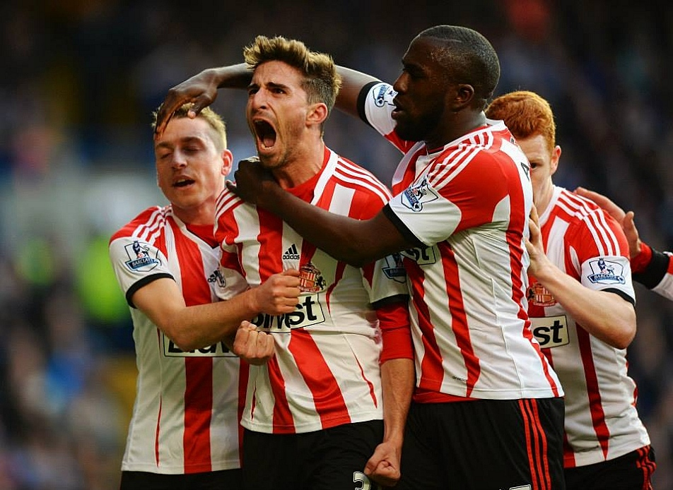 Fabio Borini of Sunderland celebrates with teammates after scoring the second goal in his club's surprise defeat of Chelsea at the weekend, keeping Sunderland's hopes alive of remaining in the Premiership.