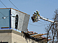 Power crews at building collapse