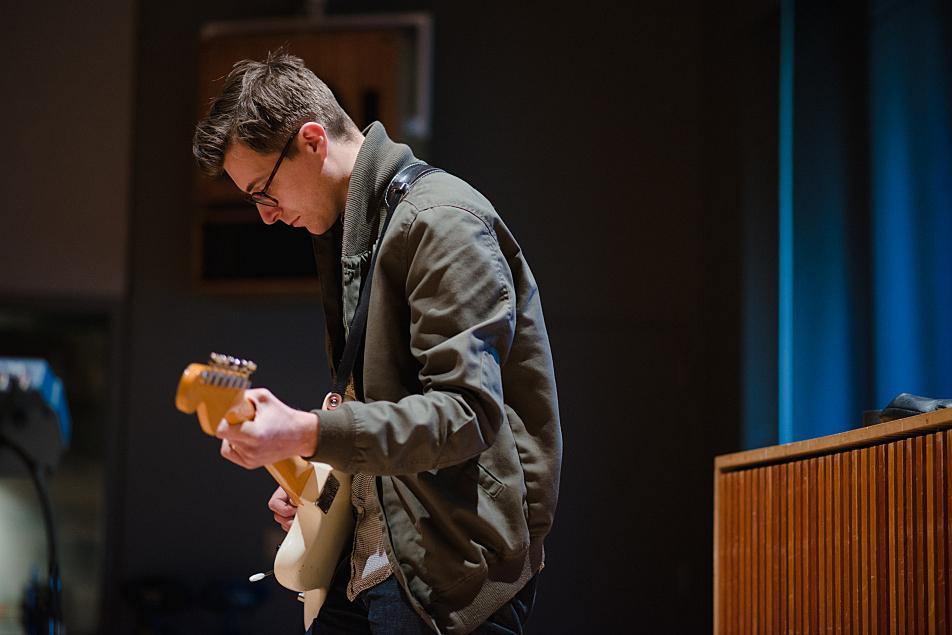 Jacob Hanson accompanies Haley Bonar on guitar.