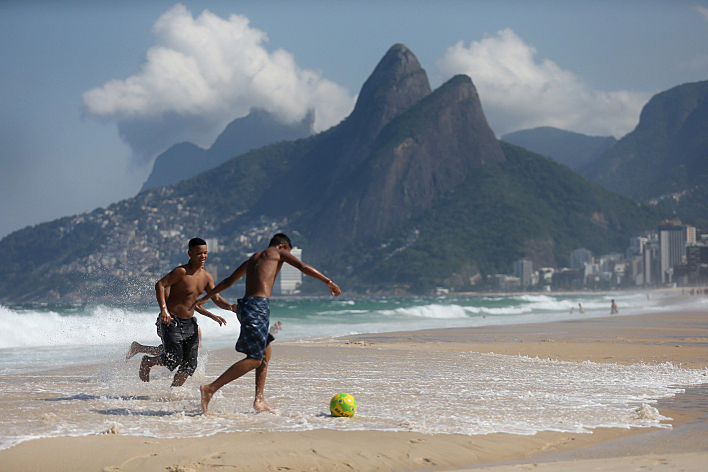 RIO DE JANEIRO, BRAZIL - JUNE 09: People play soccer on Ipanema beach on June 9, 2014, in Rio de Janeiro, Brazil. Brazil continues to prepare to host the World Cup, which starts on June 12 and runs through July 13.