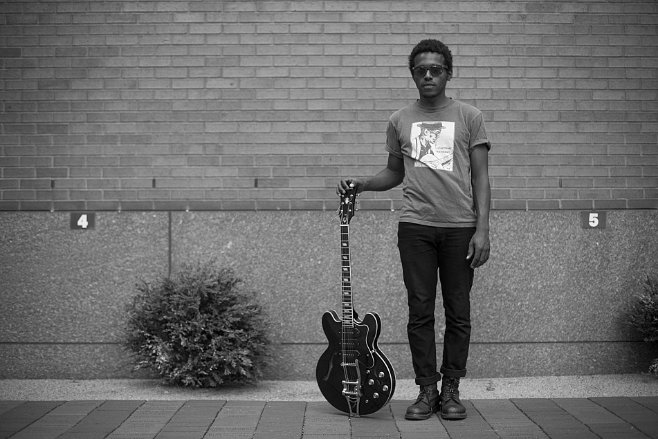 Benjamin Booker poses outside the MPR building with his Epiphone hollow-body guitar .