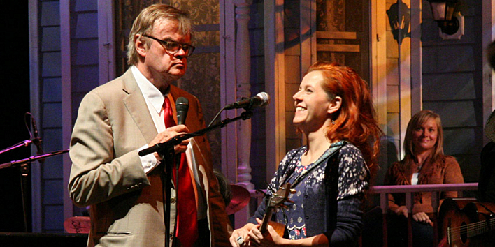 Neko Case on stage with Garrison Keillor