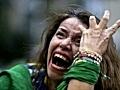 A Brazil soccer fan cries
