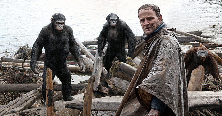 Malcolm (Jason Clarke) is followed by Caesar (Andy Serkis), Koba (Toby Kebbell) and Maurice (Karin Konoval) as he tries to make peace with them in a scene from the motion picture